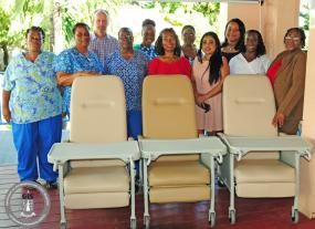 The management and staff of the Adina Donovan Home posed with managers from CIL and Real Legacy Trust next to the newly donated recliners.